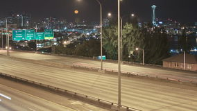 Seattle I-5 Traffic Time Lapse Night Pan. V7. Panning time lapse of I-5 freeway with Space Needle and cityscape in the background stock footage