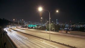 Seattle I-5 Traffic Time Lapse Night. V3. Time lapse of I-5 freeway with Space Needle and cityscape in the background stock video