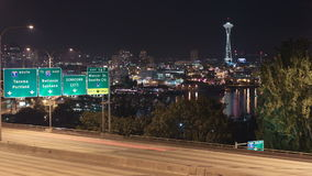 Seattle I-5 Traffic Time Lapse Night. V4. Time lapse of I-5 freeway with Space Needle and cityscape in the background stock footage