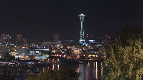 Seattle I-5 Traffic Time Lapse Night Zoom. V10. Zooming time lapse of Seattle cityscape, Lake Union, I-5 traffic, and harvest moon in upper right corner stock video