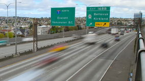 Seattle I-5 Traffic Time Lapse Pan Zoom. V12. Zoom and panning time lapse clip of Seattle I-5 freeway heading north stock video