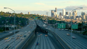 Seattle I-5 Traffic Time Lapse. V13. Interstate 5 Southbound facing traffic time lapse during sunset with Seattle cityscape in background stock video