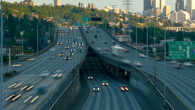 Seattle I-5 Traffic Time Lapse Zoom. V14. Interstate 5 Southbound facing traffic time lapse during sunset with Seattle cityscape in background stock video footage