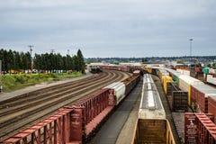 Seattle Interbay train yard looking down the box cars Stock Photos
