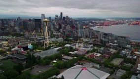Seattle in morning twilight aerial hyperlapse zooming out. This is a 4k aerial hyperlapse footage of Seattle in morning twilight stock video