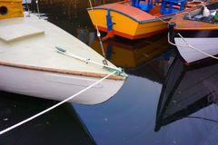 Wooden Boats Tied to Dock Royalty Free Stock Images