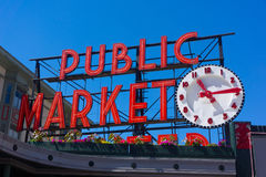 Seattle Pike Place Public Market Clock Sign. The cloudless day under bright blue sky made for a perfect backdrop to this well-know Seattle tourist attraction Stock Photo