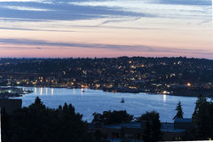 Seattle's Lake Union at Dusk. Queen Anne neighborhood in the background Royalty Free Stock Photos