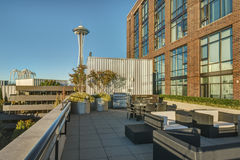 Seattle`s Space Needle rises above Rooftop Patio Stock Photography