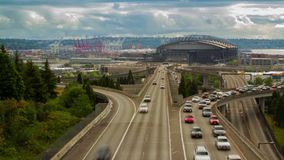 Seattle Safeco Field with High Impact Traffic. Time Lapse of High Impact Busy Traffic in Seattle Freeway stock footage