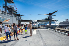 Seattle Seafair tourist on the USS Boxer. Image taken 2015 Seattle Seafair crowd of tourists on the deck of the Wasp Class amphibious assault ship USS Boxer Royalty Free Stock Photography