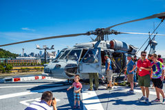 Seattle Seafair tourist on the USS Boxer. Image taken 2015 Seattle Seafair crowd of tourists on the deck of the Wasp Class amphibious assault ship USS Boxer Royalty Free Stock Photo