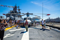 Seattle Seafair tourist on the USS Boxer. Image taken 2015 Seattle Seafair crowd of tourists on the deck of the Wasp Class amphibious assault ship USS Boxer Royalty Free Stock Image