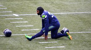 Seattle Seahawk Running Back Marshawn Lynch Stretching Royalty Free Stock Image