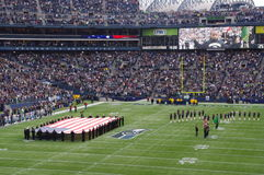 Seattle Seahawks at CenturyLink Field stadium. The American national anthem performance before Seattle Seahawks NFL game at CenturyLink Field stadium in Seattle Royalty Free Stock Images