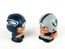 Seattle Seahawks V Oakland RaidersLi ` l lagkamrater Toy Figure Royaltyfria Bilder