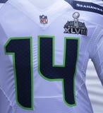 Seattle Seahawksteam eenvormig met het embleem van Super Bowl XLVIII tijdens de week van Super Bowl XLVIII in Manhattan wordt voor Royalty-vrije Stock Afbeelding