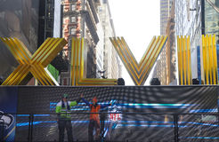 Seattle Seahawlks and Denver Broncos fans posing for picture next to Roman Numerals on Broadway during Super Bowl XLVIII week Stock Images