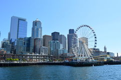 Seattle Skyline  ad Great Wheel taken from the Island Ferry Royalty Free Stock Image