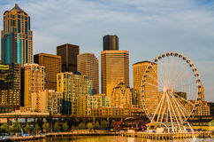 The Seattle Skyline. The skyline is bathed in golden hues at sunset. The Great Wheel on the waterfront opened in June 2012 and has become a major tourist Royalty Free Stock Images