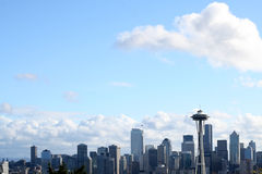 The Seattle skyline with clouds. The Seattle skyline against a blue background and clouds floating Stock Photography