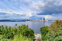 Seattle Skyline. The downtown Seattle skyline from above Alki Beach across Elliot Bay on an overcast day Stock Photo