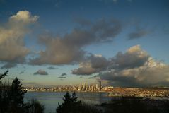 Seattle Skyline During a Dramatic Sunset and a Rain Squall Passing Through. Stock Image