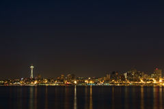 Seattle Skyline at Night. The Seattle, Washington skyline at night with Puget Sound in the foreground, with lots of sky copyspace Stock Images