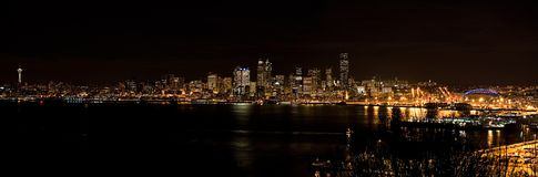 Seattle skyline at night. Night time panorama Seattle water front sky line from across the sound royalty free stock images