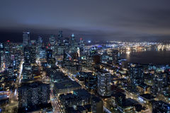 Seattle Skyline at Night from Air. The Seattle skyline at night from the air, including the bay Royalty Free Stock Photos