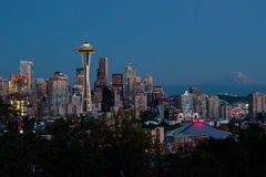 Seattle Skyline at night. With the Space Needle in the foreground and Mount Rainier in the background, taken from Kerry Park Stock Photo