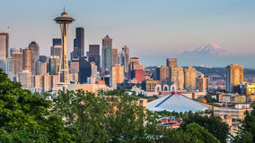 Seattle skyline panorama at sunset as seen from Kerry Park, WA, USA. Seattle skyline panorama seen from Kerry Park at sunset in golden evening light with Mount Royalty Free Stock Images