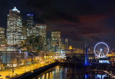 Seattle Skyline by the Pier at night Stock Photo
