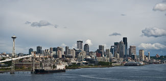 Seattle Skyline, Washington. Seattle skyline and port as seen from the waters of Elliott Bay in Puget Sound, under billowy clouds, as is typical weather for Royalty Free Stock Photos