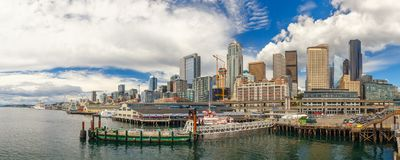 Seattle skyline and waterfront view, Washington state, USA. City skyline and waterfront of Seattle downtown from the ferry. Panoramic view royalty free stock photo