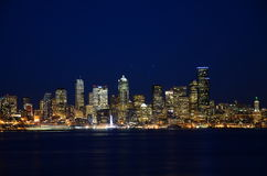 Seattle skylines at blue hour - the view from Alki Beach. Seattle, WA, USA Royalty Free Stock Photography