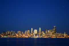 Seattle skylines at blue hour - the view from Alki Beach. Seattle, WA, USA Stock Photo