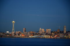 Seattle skylines at blue hour - the view from Alki Beach. Seattle, WA, USA Royalty Free Stock Photos