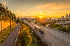 Seattle skylines and Interstate freeways converge with Elliott Bay and the waterfront background of in sunset time, Seattle, Washi. Ngton State, USA Stock Photography