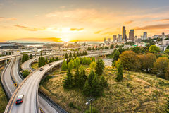 Seattle skylines and Interstate freeways converge with Elliott Bay and the waterfront background of in sunset time, Seattle, Washi Stock Photos