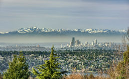 Seattle, Washington Skyline with Olympic Mountains. The Snow Capped Olympic Mountains Shield and Protect the City of Seattle, Washington on an Early Day in Stock Image