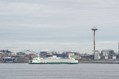 The Seattle Space Needle and cityscape with a Washington State Ferry in the foreground Stock Photography