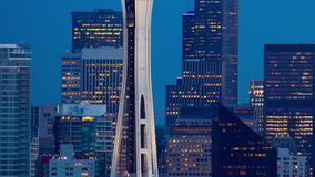 Seattle Space Needle and Downtown. Seattle, WA USA - October 7th, 2015. Elevator moving on Space Needle with Seattle downtown at background . Close up view from stock footage