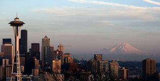 Seattle Space Needle Rainier. Seattle Space Needle and Mt. Rainier captured from on the hill of Queen Anne at Kerry Park. The setting sun casta a glow on the Royalty Free Stock Photography