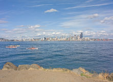 Seattle Space Needle Skyline with Kayakers. Young Girl Views Famous Seattle Space Needle and Scenic Skyline from across the Puget Sound at Alki royalty free stock image