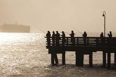 Seattle sport fishermen jig for salmon on Elliott Bay. Royalty Free Stock Images