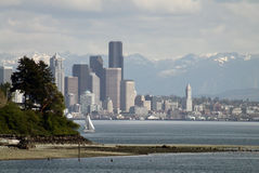 Seattle Spring. Seattle Washington waterfront with snowcap mountains and modern towers Stock Images