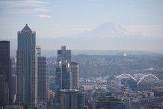 Seattle View of Mt. Rainier. A view of Mt. Rainier through light fog, with the city of Seattle, Washington, in the foreground Stock Photography