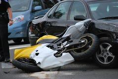 Car runs into motorcycle. SEATTLE, WA. JUNE 12, 2008. CIRCA: Car runs into motorcycle trying to make a left turn on the road stock photos