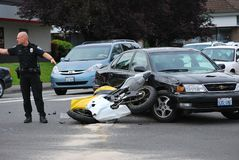 Car runs into motorcycle. Royalty Free Stock Images